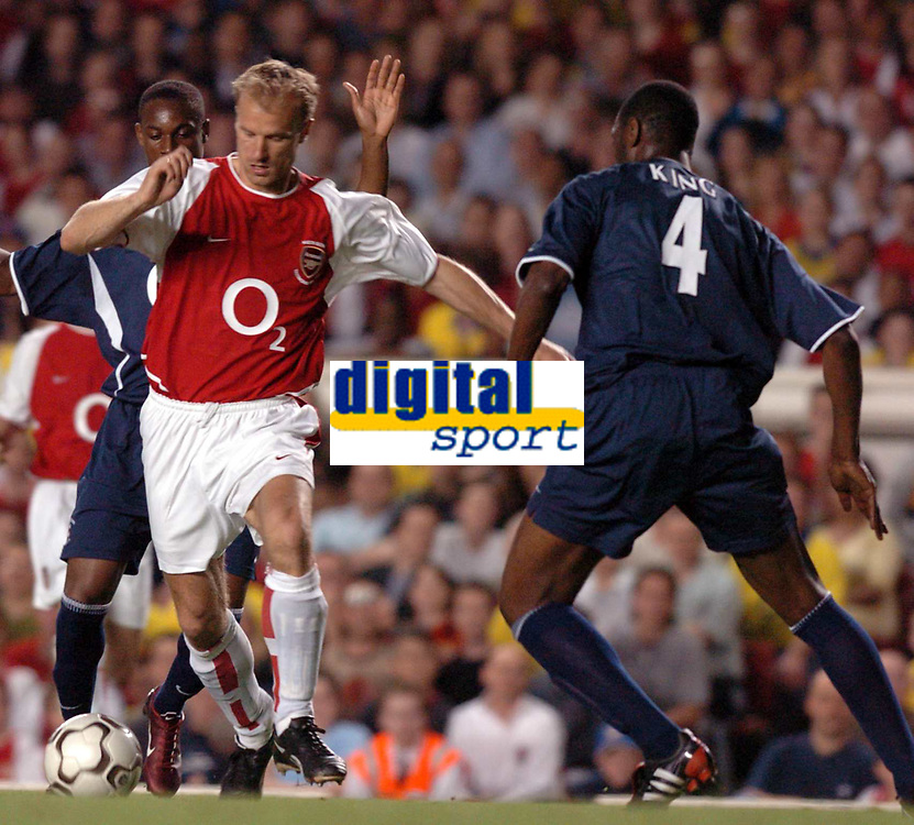Photo. Raymond Field, Digitalsport<br /> NORWAY ONLY<br /> <br /> Martin Keown Testomonial Match<br /> <br /> Arsenal v England x1<br /> 170504<br /> <br /> Dennis Bergkamp shows Ledley King how football is played