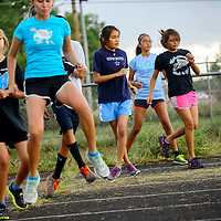 082113  Adron Gardner/Independent<br /> <br /> Window Rock Scouts warm up for cross country with a karaoke step drill in Fort Defiance Wednesday.