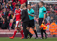Football - 2016 / 2017 Premier League - Arsenal vs. Manchester City.<br /> <br /> GranitXhaka of Arsenal acts as peacemaker after Pep Guardiola Manager of Manchester City confronts referee Andre Marriner at The Emirates.<br /> <br /> COLORSPORT/DANIEL BEARHAM