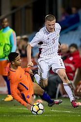 (L-R) Justin Kluivert of Jong Oranje, Litvinskis Viktors of Jong Letland during the EURO U21 2017 qualifying match between Netherlands U21 and Latvia U21 at the Vijverberg stadium on October 06, 2017 in Doetinchem, The Netherlands