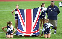 27.07.2010, Wetzlar Stadion, Wetzlar, GER, Football EM 2010, Team France vs Team Great Britain, im Bild Tariq Ayub, (Team Great Britain, Headcoach) neben Cheerleader mit englischer Fahne,  EXPA Pictures © 2010, PhotoCredit: EXPA/ T. Haumer
