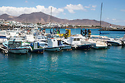 Fishing boats in the harbour at Playa Blanca, Lanzarote, Canary Islands, Spain