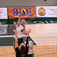 3rd year middle blocker Cody Caldwell (4) of the Regina Cougars in action during the Women's Volleyball Home Game vs U of C Dinos on October21 at the CKHS University of Regina. Credit Arthur Ward/©Arthur Images 2017