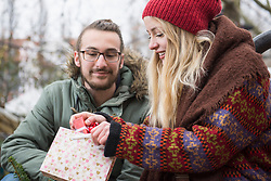 Young woman taking gift from bag
