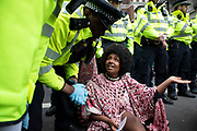 Police speak to one protester as they try to clear climate change activists from the Extinction Rebellion group at Oxford Street near to the Marble Arch camp in protest that the government is not doing enough to avoid catastrophic climate change and to demand the government take radical action to save the planet, on 24th April 2019 in London, England, United Kingdom. Extinction Rebellion is a climate change group started in 2018 and has gained a huge following of people committed to peaceful protests.