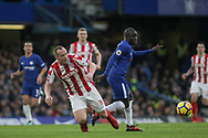 Charlie Adam of Stoke City and N'golo Kante of Chelsea battle for the ball .<br /> Premier league match, Chelsea v Stoke city at Stamford Bridge in London on Saturday 30th December 2017.<br /> pic by Kieran Clarke, Andrew Orchard sports photography.