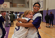 Sveta Kornienko, 16, hugs teammate Kelly Malone after the final home game for the Sacramento High School women's varsity.  Sveta is a foreign exchange student from Petrozavodsk, Russia and was a subsitute player as part of her experience in the U.S.   February 20, 2003.