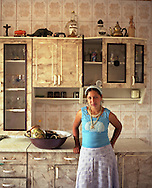 Fraga stands in the kitchen of a home, in the village of Sintesti, in Romania, early August 2006. The roma women of the village do not attend school, even as children, or have employment, instead staying home to raise children and do housework. The Kalderari roma of Sintesti are by tradition metal workers, originally making alcohol stills, pots and pans, but now dealing in scrap metal. The large profits from their business have enabled them to build large houses in the village of Sintesti, 20km from Bucharest, and to invest in fast, Western brand name cars such as BMW's, Mercedes and Porsche.