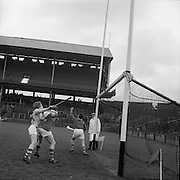 27/03/1966<br /> 03/27/1966<br /> 27 March 1966<br /> National Hurling League, Division II: Antrim v Kerry at Croke Park, Dublin. <br /> Kerry goalie, T. McElligott (right) catches the ball to save a goal with Kerry back, M. J. Quinlan holding off B. Campbell.