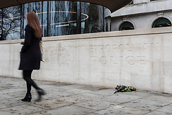 © Licensed to London News Pictures. 23/03/2017. London, UK. Flowers are laid outside New Scotland Yard in London for PC Keith Palmer who was killed in the Westminster terrorist attack. Photo credit: Rob Pinney/LNP