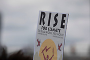 Rise For Climate Change placard at the event held outside Tate Modern in London, England, United Kingdom on September 8th 2018. Tens of thousands of people joined over 830 actions in 91 countries under the banner of Rise for Climate to demonstrate the urgency of the climate crisis. Communities around the world shined a spotlight on the increasing impacts they are experiencing and demanded local action to keep fossil fuels in the ground. There were hundreds of creative events and actions that challenged fossil fuels and called for a swift and just transition to 100% renewable energy for all. Event organizers emphasized community-led solutions, starting in places most impacted by pollution and climate change. Photographed for 350.org.