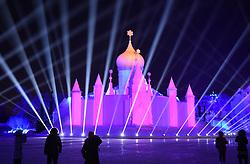 Jan. 3, 2018  - Harbin, China - Tourists enjoy the show at the Sun Island International Snow Sculpture Art Expo in Harbin, capital of northeast China's Heilongjiang Province. Snow Wonderland, a 3D snow-light show applying modern sound, light and digital technologies has been displayed at Sun Island International Snow Sculpture Art Expo in recent days. (Credit Image: © Wang Jianwei/Xinhua via ZUMA Wire)