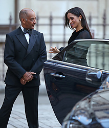 The Duchess of Sussex closes the door of the car she arrived in, as she is met by the Lord-Lieutenant of Greater London Sir Kenneth Olisa upon arriving at the opening of Oceania at the Royal Academy of Arts in London.