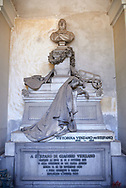 Picture and image of a mourning women  stone sculpture in the realistic borgeois style. The tomb of the Stefano family Tsculpted by by G Benetti 1877. The monumental tombs of the Staglieno Monumental Cemetery, Genoa, Italy .<br /> <br /> Visit our ITALY PHOTO COLLECTION for more   photos of Italy to download or buy as prints https://funkystock.photoshelter.com/gallery-collection/2b-Pictures-Images-of-Italy-Photos-of-Italian-Historic-Landmark-Sites/C0000qxA2zGFjd_k<br /> If you prefer to buy from our ALAMY PHOTO LIBRARY  Collection visit : https://www.alamy.com/portfolio/paul-williams-funkystock/camposanto-di-staglieno-cemetery-genoa.html