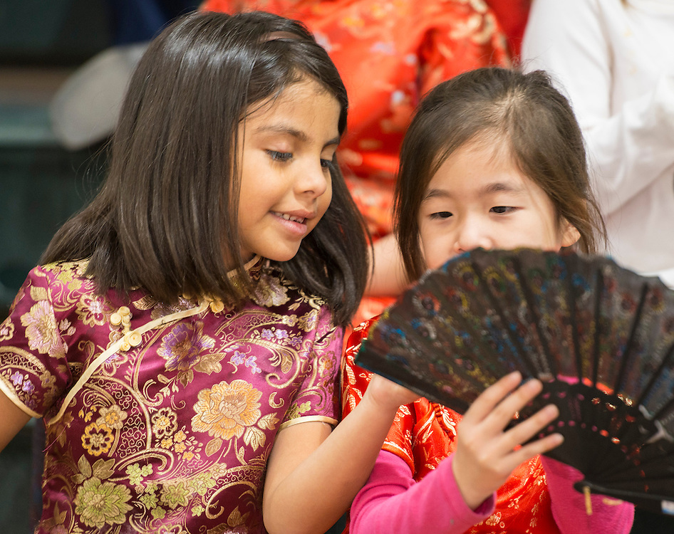 Students from the Mandarin Chinese Emersion School get ready to perform during a district wide celebration of the Chinese New Year at Sharpstown International School, February 22, 2014.