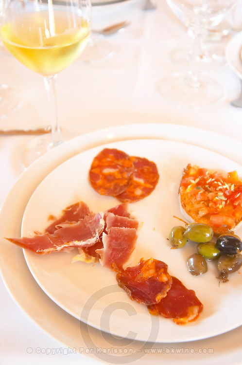 In the restaurant. Dry cured ham. Sausages. Charcuteries.  Herdade da Malhadinha Nova, Alentejo, Portugal