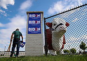 William Brown, a supporter of former U.S. Vice President Joe Biden, 2020 Democratic presidential candidate, posts campaign signs at the entrance to an event in Davenport, Iowa. <br /> Photo by Jim Young for Bloomberg
