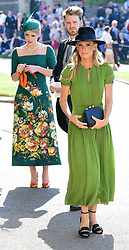 Lady Kitty Spencer (centre) and Victoria Aitken (right) arrive at St George's Chapel at Windsor Castle for the wedding of Meghan Markle and Prince Harry.