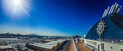 An iPhone6 panoramic image with the Dubai skyline, from the MSC Musica in the port of Dubai. Images from the MSC Musica cruise to the Persian Gulf, visiting Abu Dhabi, Khor al Fakkan, Khasab, Muscat, and Dubai, traveling from 13/12/2015 to 20/12/2015.