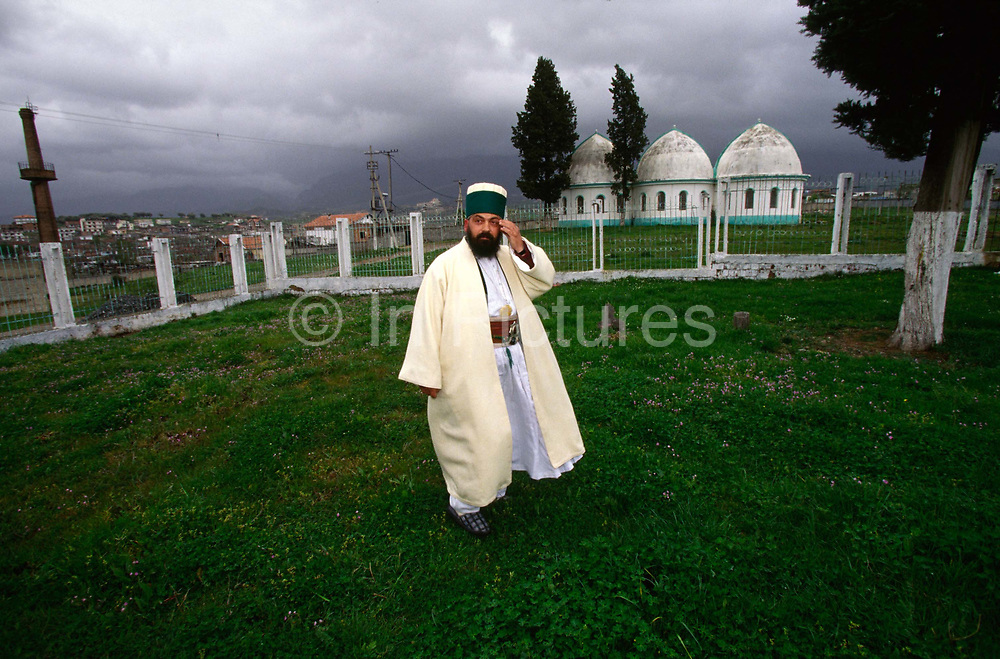 A Bektashi Dervish in the grounds of their orders' house in Tirana Albania. The Bektashi's are an order of Sufi's, Muslim mystics and were persecuted along with all other religions under the Communist regime