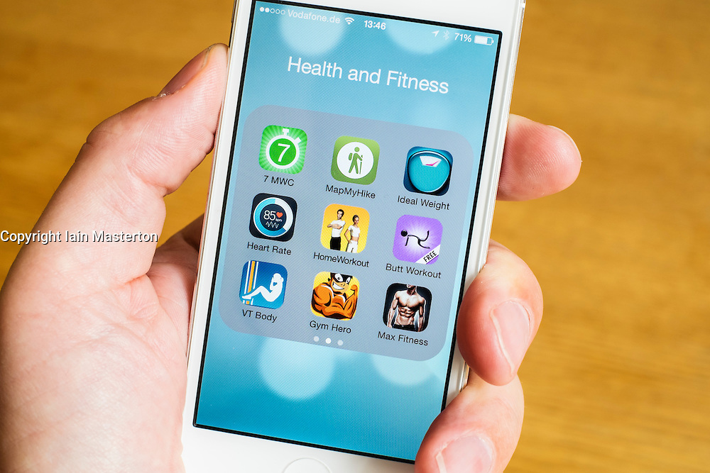 Detail of many health ,sport and fitness apps on a iPhone smart phone