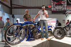 Custom builder Dustin Maybin of Hendersonville, NC speaking about his all metal bagger on display at the Old Iron - Young Blood exhibition media and industry reception in the Motorcycles as Art gallery at the Buffalo Chip during the annual Sturgis Black Hills Motorcycle Rally. Sturgis, SD. USA. Sunday August 6, 2017. Photography ©2017 Michael Lichter.