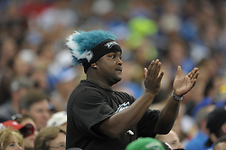 DETROIT - SEPTEMBER 19: A Philadelphia Eagles fan cheers during the game against the Detroit Lions on September 19, 2010 at Ford Field in Detroit, Michigan. (Photo by Drew Hallowell/Getty Images)  *** Local Caption ***