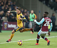 West Ham's Arthur Masuaku tussles with Arsenal's Mesut Ozil during the Premier League match at the London Stadium, London. Picture date December 3rd, 2016 Pic David Klein/Sportimage