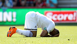 Swansea City's Jordan Ayew (right) rues a missed chance during the Premier League match at the Vitality Stadium, Bournemouth.