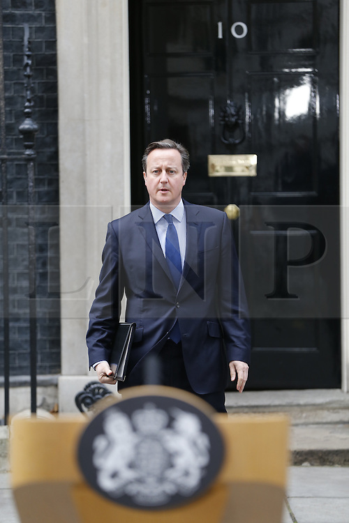 "© Licensed to London News Pictures. 13/11/2015. London, UK. Prime Minister David Cameron giving a statement about British terrorist dubbed as ""Jihadi John"" in Downing Street on Friday, 13 November 2015. Photo credit: Tolga Akmen/LNP"