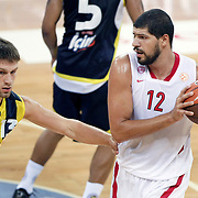 Fenerbahce Ulker's Gasper VIDMAR (L) and Olimpiakos's Lazaros PAPADOPOULOS (R) during their Two Nations Cup basketball match Fenerbahce Ulker between Olimpiakos at Abdi Ipekci Arena in Istanbul Turkey on Saturday 01 October 2011. Photo by TURKPIX
