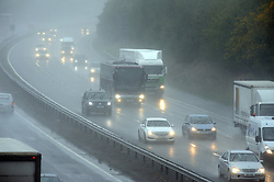 © Licensed to London News Pictures. 13/10/2014<br /> Traffic on the M25 at Junction 3 for Swanley,Kent.  Very Heavy rain making dangerous driving conditions on the M25 this morning (13.10.2014) <br /> (Byline:Grant Falvey/LNP)