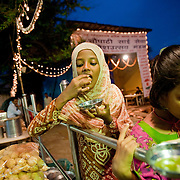 Children visiting chowpati beach just after sunset, enjoy Pani Puri, a favorite street food snack. Mumbai, August 2009