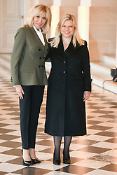 French President's wife Brigitte Macron welcomes Israel's Prime Minister's wife Sara Netanyahu as they take part in a spousal event at the Chateau de Versailles in Versailles, near Paris, on November 11, 2018 as part of commemorations marking the 100th anniversary of the 11 November 1918 armistice, ending World War I. Photo By Laurent Zabulon/ABACAPRESS.COM