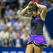 2019 US Open Tennis Tournament- Day Eleven.  Bianca Andreescu of Canada  adjusts her hair during her match against Belinda Bencic of Switzerland in the Women's Singles Semi-Finals match on Arthur Ashe Stadium during the 2019 US Open Tennis Tournament at the USTA Billie Jean King National Tennis Center on September 5th, 2019 in Flushing, Queens, New York City.  (Photo by Tim Clayton/Corbis via Getty Images)