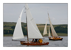 Hatasoo  with the McGrouthers Brother's sailing their 1894 Gunter Sloop with Ayrshire Lass to windward...The Round the Cumbraes race to open the regatta. Light variable breeze and grey skies shrouded the fleet with a strong spectator fleet...* The Fife Yachts are one of the world's most prestigious group of Classic .yachts and this will be the third private regatta following the success of the 98, .and 03 events.  .A pilgrimage to their birthplace of these historic yachts, the 'Stradivarius' of .sail, from Scotland's pre-eminent yacht designer and builder, William Fife III, .on the Clyde 20th -27th June.   . ..More information is available on the website: www.fiferegatta.com . .Press office contact: 01475 689100         Lynda Melvin or Paul Jeffes