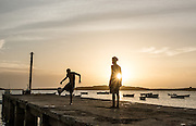 Cabo Verde, Boa Vista, boys playing football on tghe pier in Sal Rei