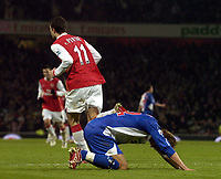 Photo: Olly Greenwood.<br />Arsenal v Blackburn Rovers. The Barclays Premiership. 23/12/2006. Arsenal's Robin Van Persie celebrates scoring while Blackburn's Morton Gamst Pedersen looks dejected