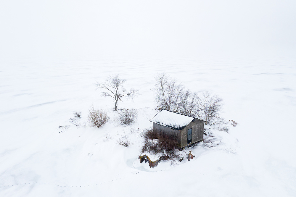 https://Duncan.co/small-island-with-cabin-surrounded-by-ice
