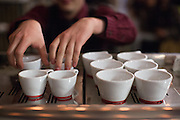 Justin Williams, 25, of Front Café in San Francisco prepares his workstation during the 2nd Annual Mock Barista Competition and Brewer's Cup at San Pedro Square Market in San Jose, California, on February 21, 2013.  (Stan Olszewski/SOSKIphoto)
