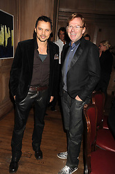 Left to right, JERRY DE VEAUX and DAVID COLLINS at a party to celebrate the launch of Hollywood Domino - a brand new board game, held at Mosimann's 11b West Halkin Street, London on 7th November 2008.  The evening was in aid of Charlize Theron's Africa Outreach Project.