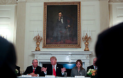 Washington, DC - February 3, 2017; U.S. President Donald speaks before a strategy and policy forum, while CEO of the Blackstone Group Stephen Allen Schwarzman (L) and Chief Executive Officer and Chairperson of the General Motors Mary Barra (R) in the State Dining Room of the White House.