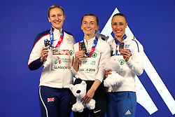 Great Britain's Holly Bradshaw (left), Anzhelika Sidorova, and Greece's Nikoleta Kiriakopoulou celebrates with their medals at the Women's Pole Vault Final during day three of the European Indoor Athletics Championships at the Emirates Arena, Glasgow.