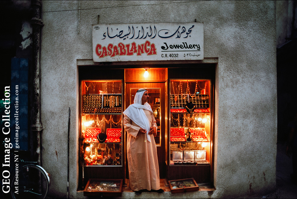 A jewelry store owner awaits customers in the Manama Souq in Bahrain--a warren of narrow streets and alleyways where shoppers can find everything from electronic goods to spices and shisha pipes.