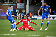 No way past Scunthorpe Utd forward Kyle Wootton (29) for Peterborough Utd midfielder Louis Reed (11) during the EFL Sky Bet League 1 match between Peterborough United and Scunthorpe United at London Road, Peterborough, England on 1 January 2019.