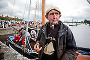 "Paddy Dundass,Kilkeerin,Connemara takes a break from unloading the turf from ""Capall"" the oldest boat taking part in the Crinniú na mBad,Kinvara,Co Galway at the weekend. Photograph by Eamon Ward"