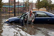 Mike Donofrio emerges from his car after it stalled in the flood waters in Hoboken, New Jersey, Wednesday , October 31, 2012.  The National Guard was called in to assist in the evacuation of residents.  Photographer: Emile Wamsteker/Bloomberg News