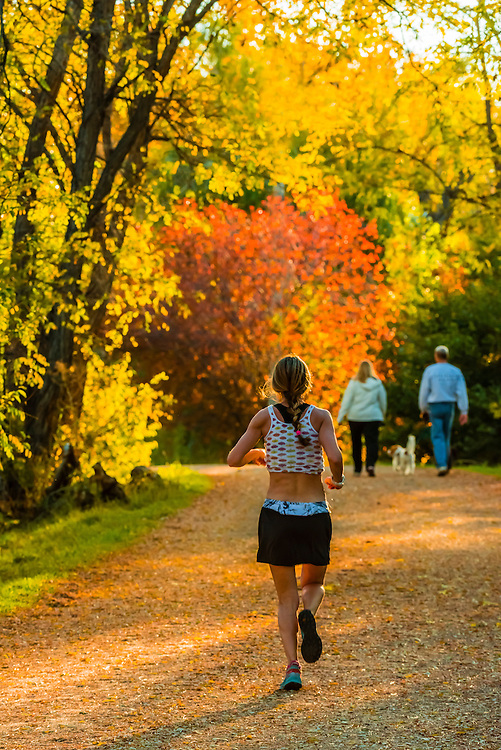 People on the Highline Canal path on an Autumn afternoon, Littleton, Colorado USA.