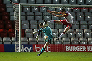 Stevenage's Jason Cowley(9) attempts to block Forest Green Rovers goalkeeper Adam Smith(1) clearance during the EFL Sky Bet League 2 match between Stevenage and Forest Green Rovers at the Lamex Stadium, Stevenage, England on 26 December 2019.