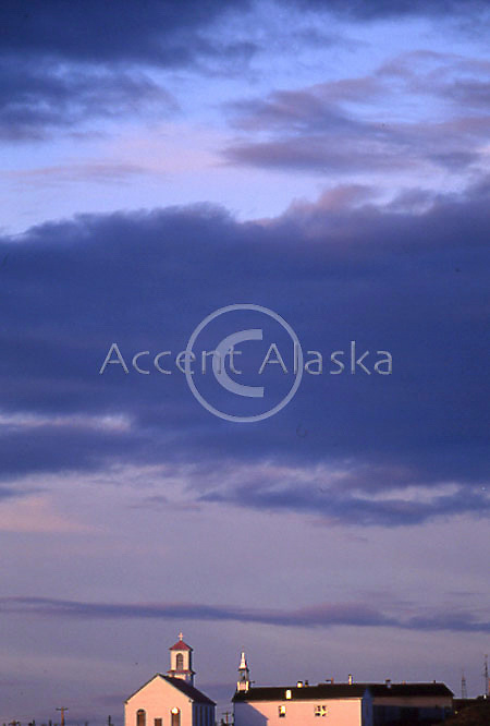 Canada. Northwest territories. Arctic Red River midnight sun on church top.